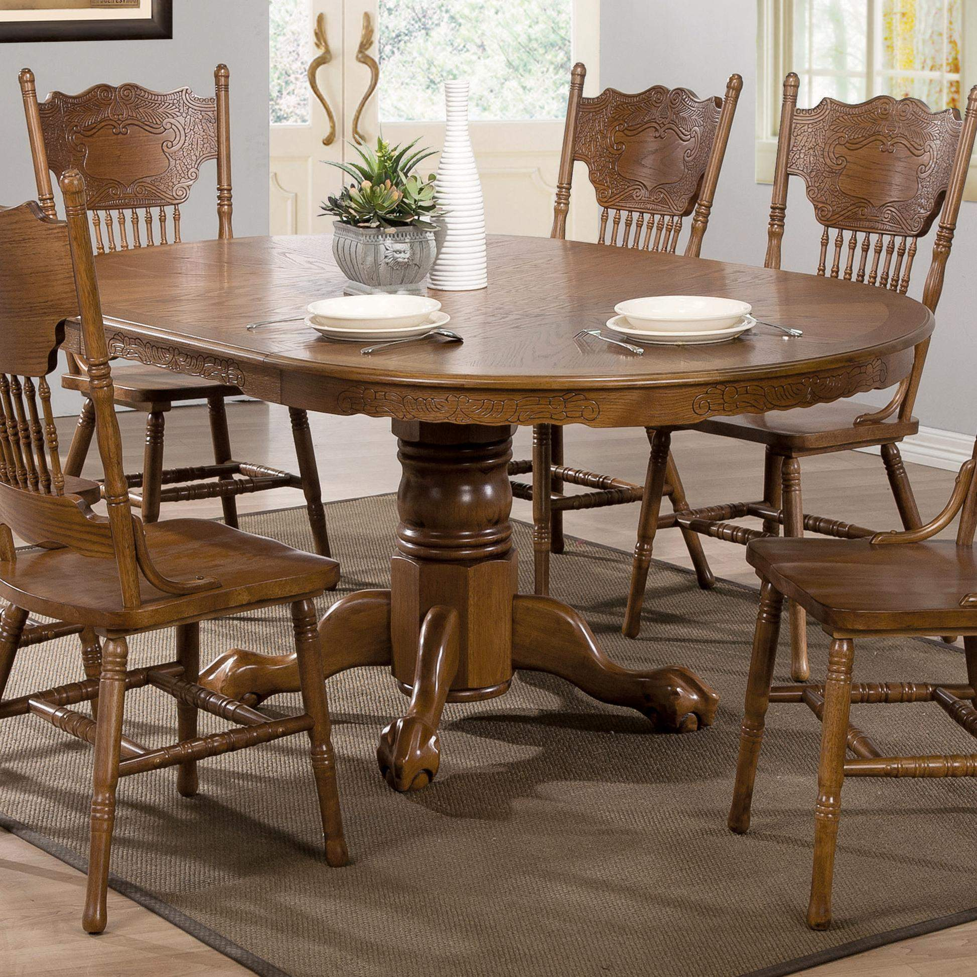 Brooks Oak Finish Round Oval Dining Table With Single