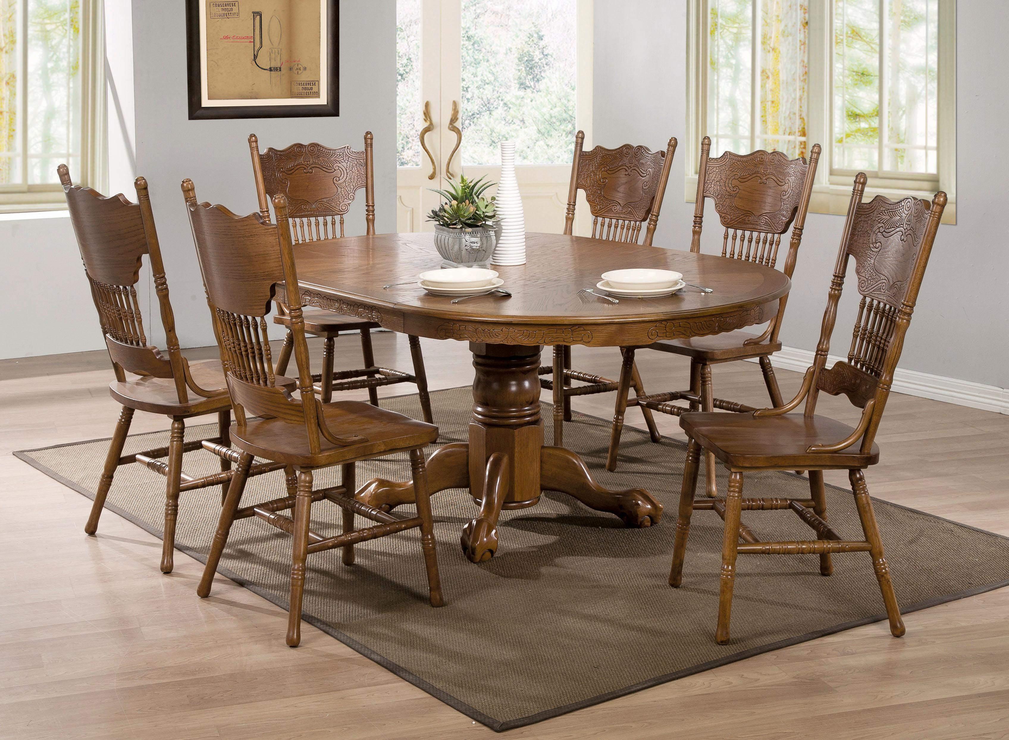 Brooks Oak Finish Round Oval Dining Table With Single Pedestal Amp Decorative Apron